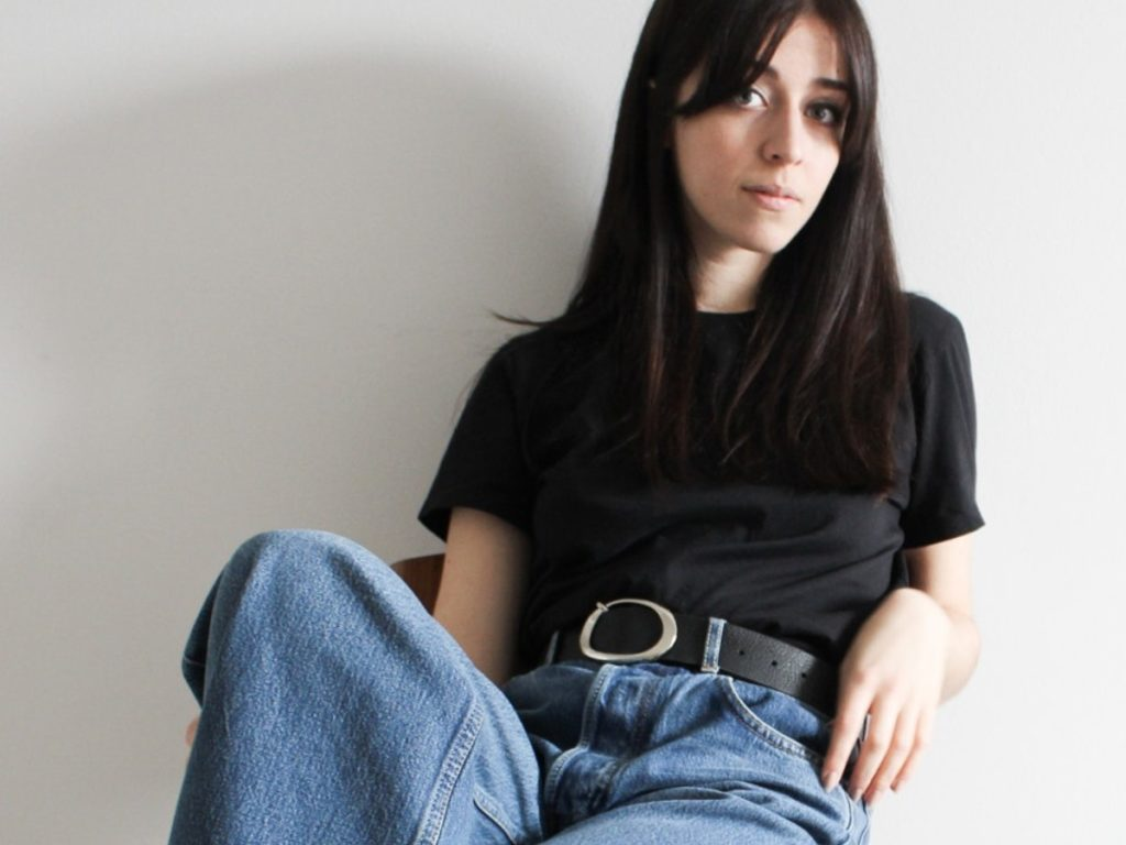 Besma Whayeb Interview | Black t-shirt and blue jeans outfit