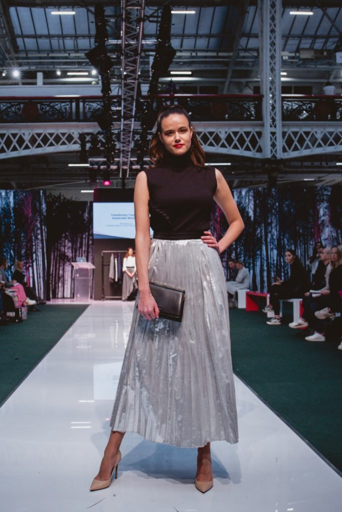 Model Amanda Sarco Styled By Roberta Lee, Pure London Runway Feb 2020 | Conscious Fashion Brands | Black Dress, Metallic Skirt, Black Clutch