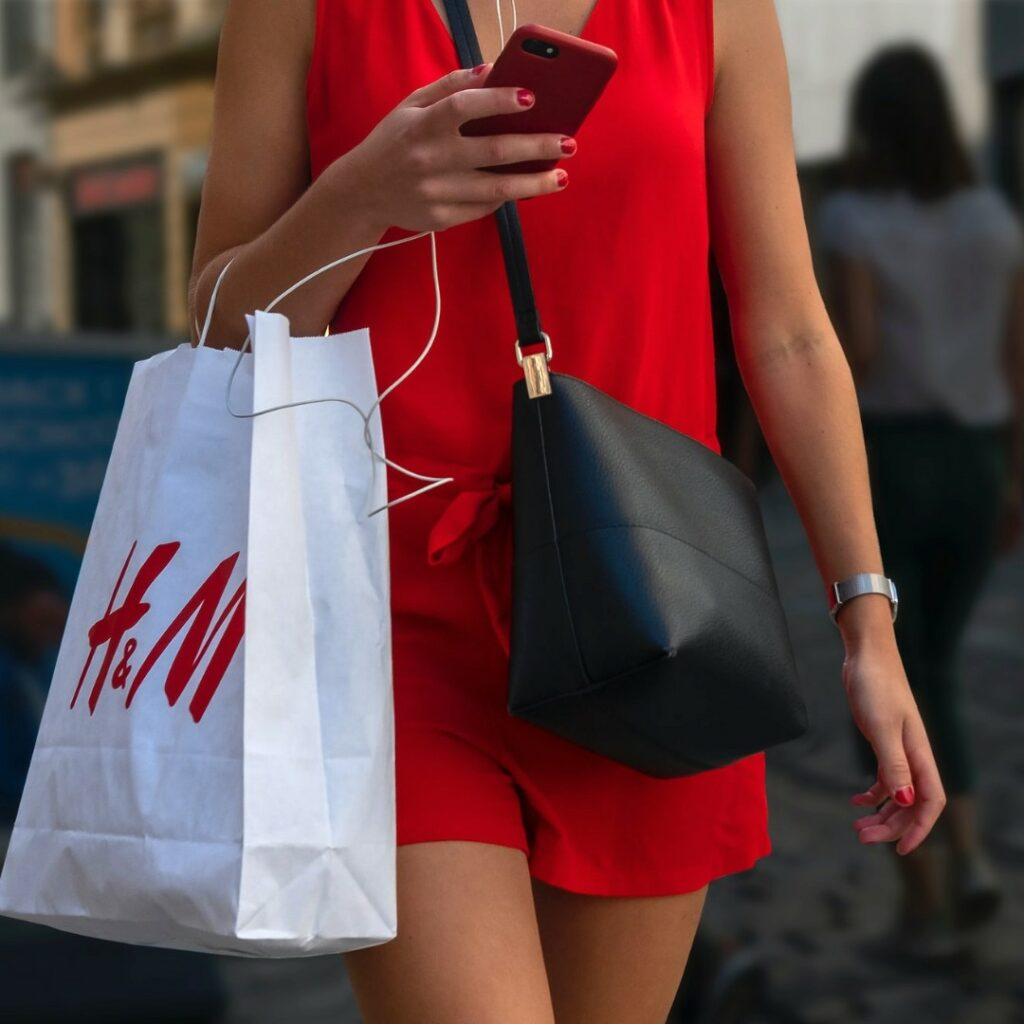 Woman shopping at highstreet retailer H&M | Fast fashion brand