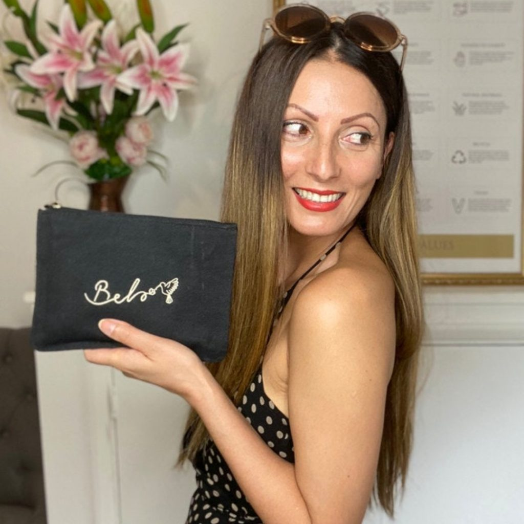 Ethical and sustainable pouch | made from recycled plastic bottles | Modeled by Roberta Lee | From Belo brand