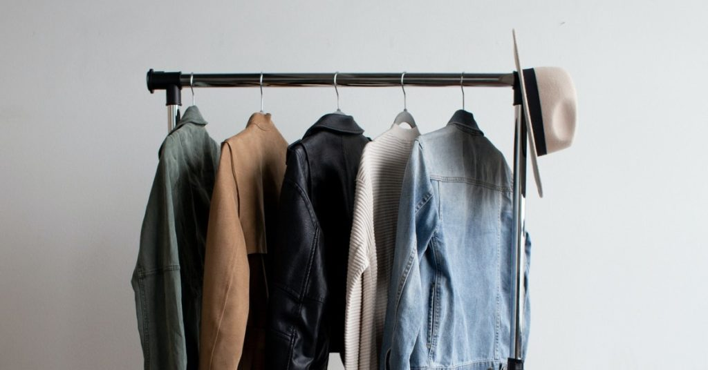 Clothes Rail with Denim Jacket, Leather Jacket, Jumper and Hat | Swap, borrow and rent | Tips for a greener wardrobe