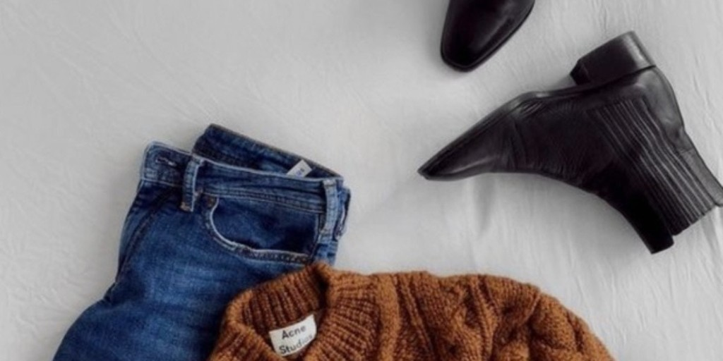 MInimal fashion flat lay | Brown Acne Studios Jumper, blue denim jeans and black boots | Clothing repair tips | Care for your clothes tips