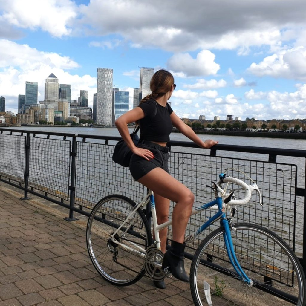 Roberta Lee Cycling in London on blue bicycle | Sustainable, eco-friendly travel